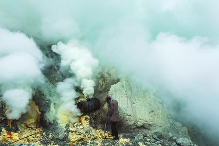 JAVA, INDONESIA - JANUARY 21, 2016: Extracting sulphur inside Kawah Ijen crater, Indonesia