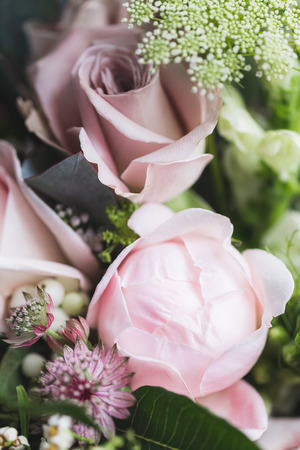 Beautiful wedding bouquet with roses and peonies closeup Stock Photo