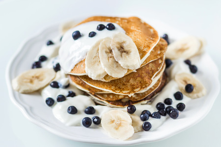 blini: Homemade pancakes with banana, blueberries and sour cream