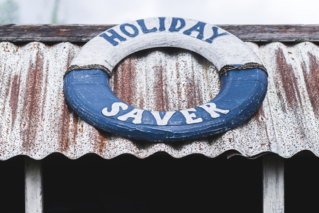 lifeline: Wooden lifeline as a decoration with the sign Holiday Saver Stock Photo