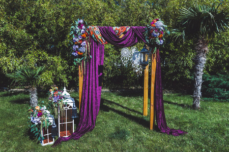Wedding ceremony decorated in boho style