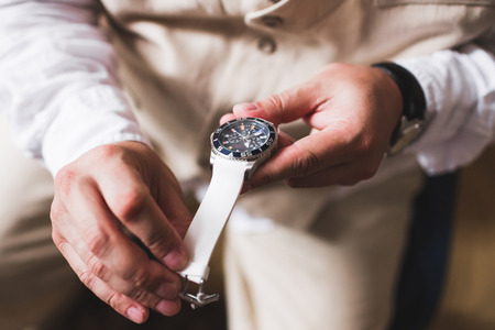 his shirt sleeves: Groom tries on a new watches Stock Photo