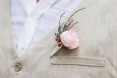 boutonniere: Gentle groom boutonniere with a rose