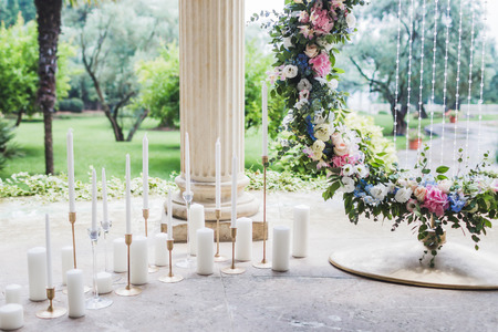 arching: Wedding decorations with a lot of candles Stock Photo