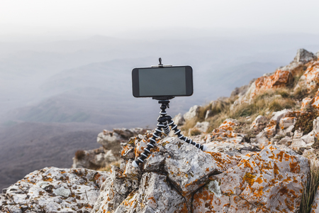Making photo with a long exposure on mobile phone with mini-tripod