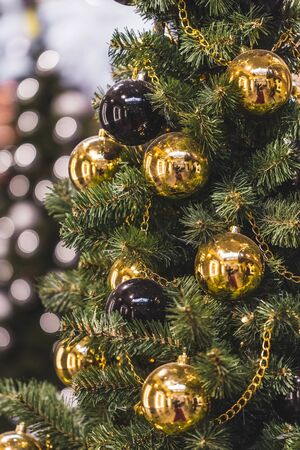 Decoration Christmas tree with plenty of gold and black balls Stock Photo