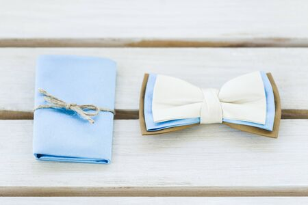 cufflink: Groom set: bow tie, a scarf, in beige and blue colors. View from above Stock Photo