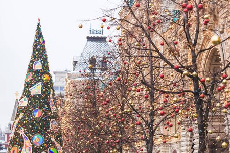 stock photo streets fully decorated for christmas with red and gold balls christmas tree in the city house illuminated with a lot lights - Fully Decorated Christmas Trees