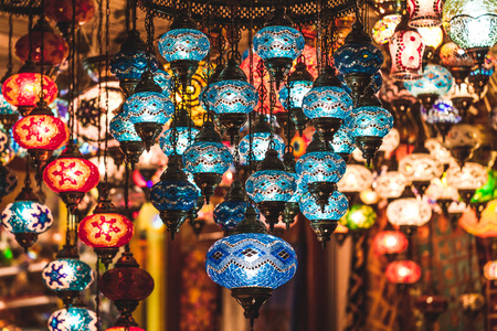 Amazing traditional handmade turkish lamps in souvenir shop. Mosaic of colored glass. Lit in the evening, creating a cozy atmosphere Stock Photo