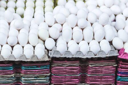 product range: Many white eggs at market, background Stock Photo