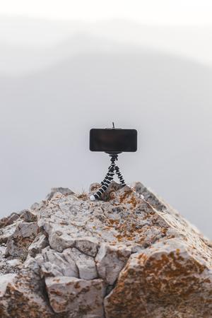 mobile phone with mini-tripod
