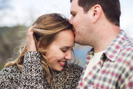 True emotions of happy loving couple. Close up portrait of laughing people