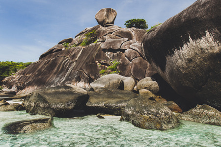 Rocky coast of paradise island with transparent crystal and clear water. Vacation in Similan Stock Photo