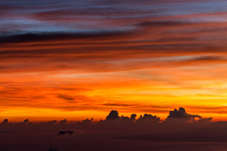 Amazing colorful sunrise at top of Agung Volcano in Bali. Multicolor cloud pattern at background, space for text and sign. Colorful sky Stock Photo