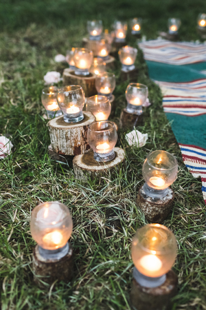 Night wedding ceremony with a lot of vintage lamps and candles 스톡 콘텐츠