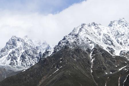 Snow mountain peaks of Caucasus mountains in cold cloudy weather, Elbrus Region. Main caucasian ridge Archivio Fotografico