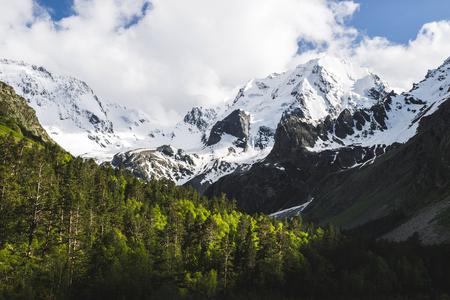 Snow mountain peaks of Caucasus mountains in cold cloudy weather, Elbrus Region. Top of Ullu-Tau mountain