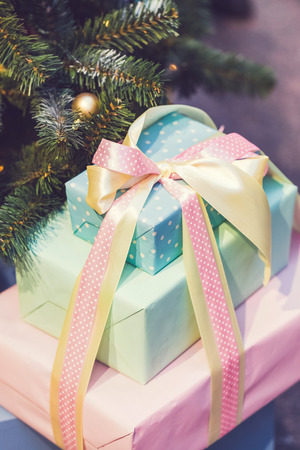 Beautiful boxes with gifts under a decorated Christmas tree Stock Photo