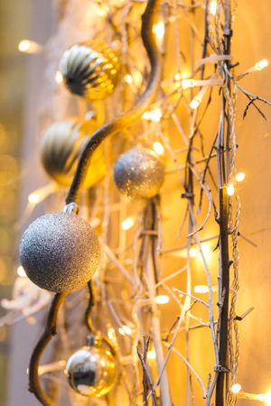 Street decorations for New Year and Christmas with silver balls and flickering garlands in evening Stock Photo