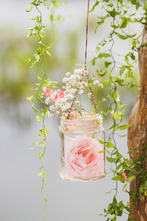Wedding decoration, rose in transparent hanging jar, white and pink flowers, rustic style