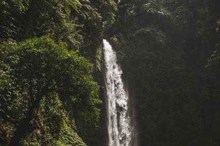 Huge waterfall Nung Nung in Bali jungle