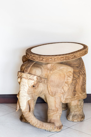 Wooden carved table in elephant shape