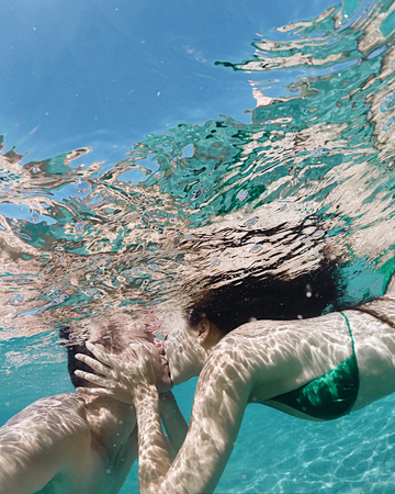 Couple kissing underwater