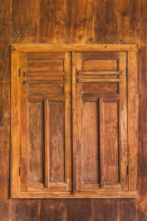Closed wooden window with shutters