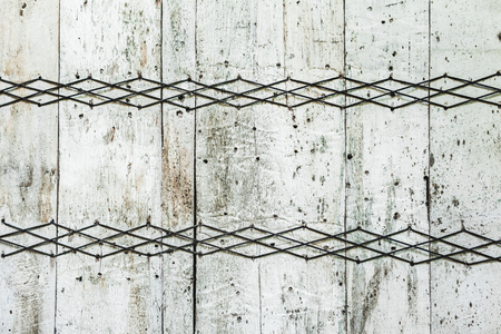 Old wooden texture with wicker ornament