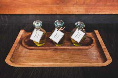 Set of massage oil on wooden plate in tropical spa in Bali. For relaxation, meditation and inspiration Stock Photo