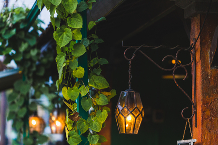 Old beautiful hanging lamp outside in cafe garden made from stained glass, moroccan style