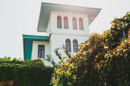 White house with blue roof in traditional oriental style