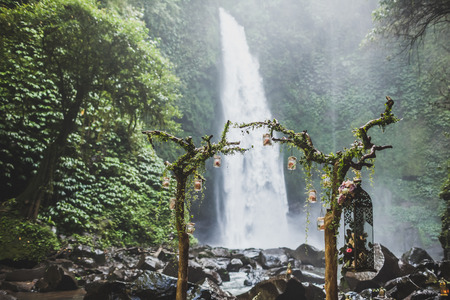 Wedding ceremony in jungle with waterfall view