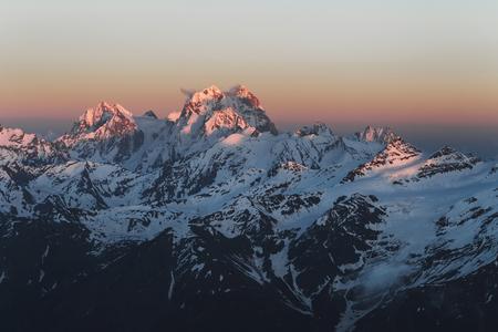 Panoramic view on Ushba peak at sunset from Elbrus. Mountain range view