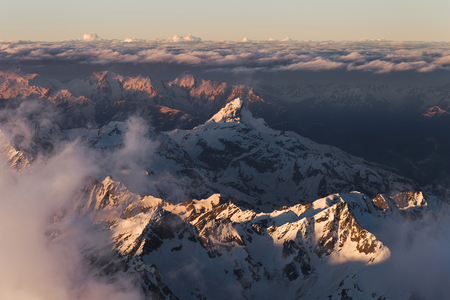Panoramic view of high mountain peaks in beautiful morning light. Hiking and climbing in Elbrus region