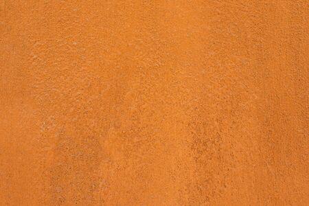 Fond de couleur terre cuite marocaine traditionnelle. Texture de mur d'argile orange ou ocre. Béton minable peint.