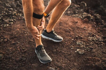Runner using Knee support bandage and have a problem with leg injury on running. Periosteum problem or sprain ligament. Stock Photo