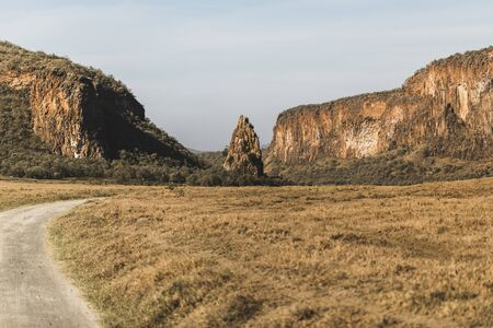 Safari in Hells Gate national park in Kenya. Basalt mountain and rock, main landmark. Explore wilderness of Africa.