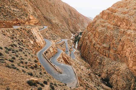 Curve serpentine winding road in Dades Gorge mountain canyon. Famous Morocco tourist landmark, R704 way. Aerial view.