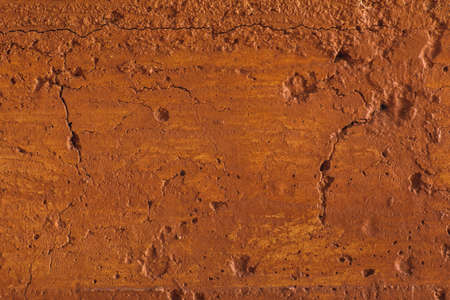 Traditional moroccan terracotta colored background. Orange or ocher clay wall texture. Painted shabby concrete.