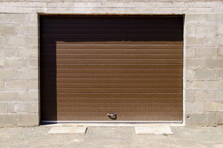 stone garage with roller blinds door