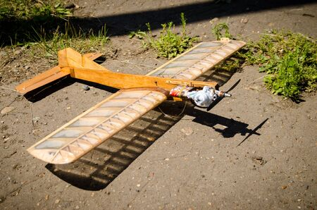 small homemade wooden plane standing on the ground before the flight Banco de Imagens