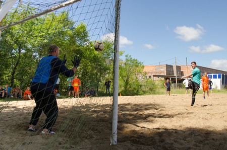 Komsomolsk-on-Amur, Russia - August 8, 2016. Public open Railroaders day. football player is on goal in amateur beach soccer championship