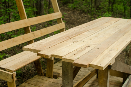 construction of wooden table and benches under canopy with in the forest Archivio Fotografico