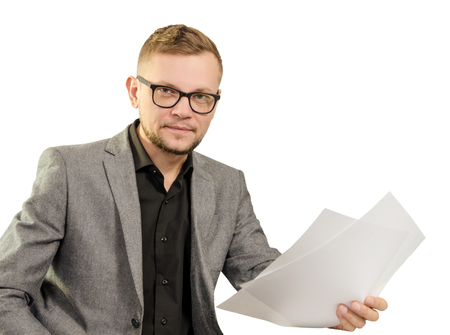 man in glasses and jacket with documents in his hand smiling to look at camera isolated on white background.