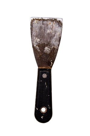 metal rusty putty knife with plastic handle with hole isolated on white background. Фото со стока