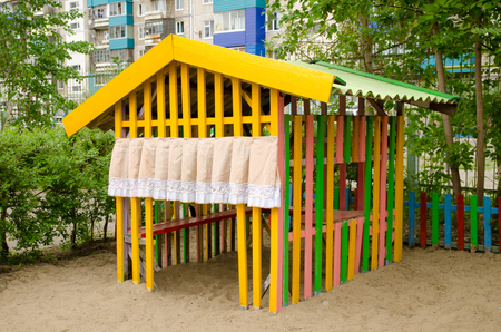 childrens play house on sand playground.