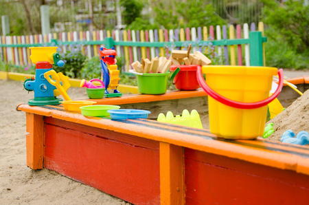 playground with sandbox with shovels, buckets for children's games.