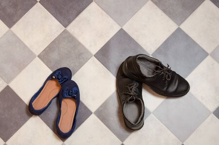 light and comfortable blue womens shoes and mans shoes on  black and white checkered floor.
