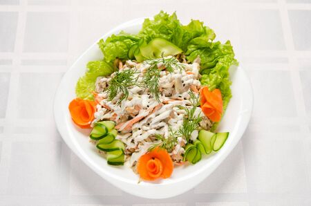 salad of boiled beef, champignons, carrots, pickled cucumbers, onions and lettuce seasoned with mayonnaise. Stock Photo